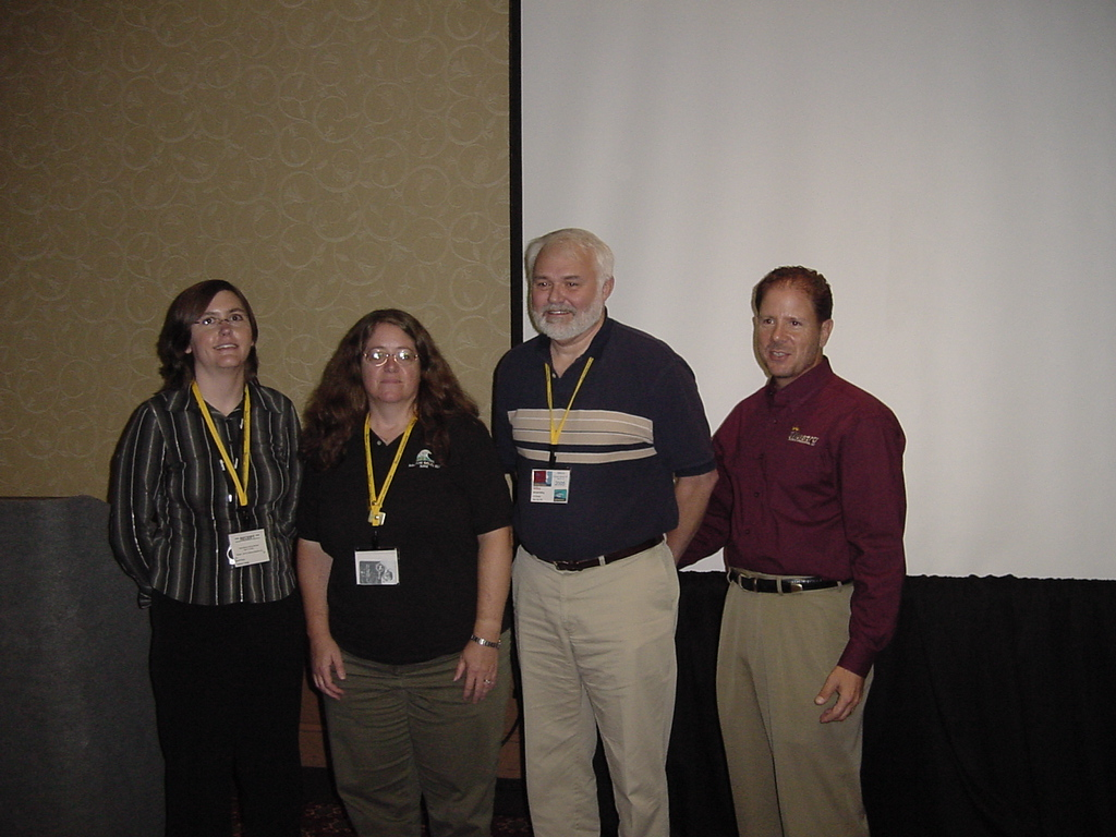 Sarah Kranz, Ellen Alexander, Mike Milling, and Eric Vaughan after the z/Web-Host customer success presentation.