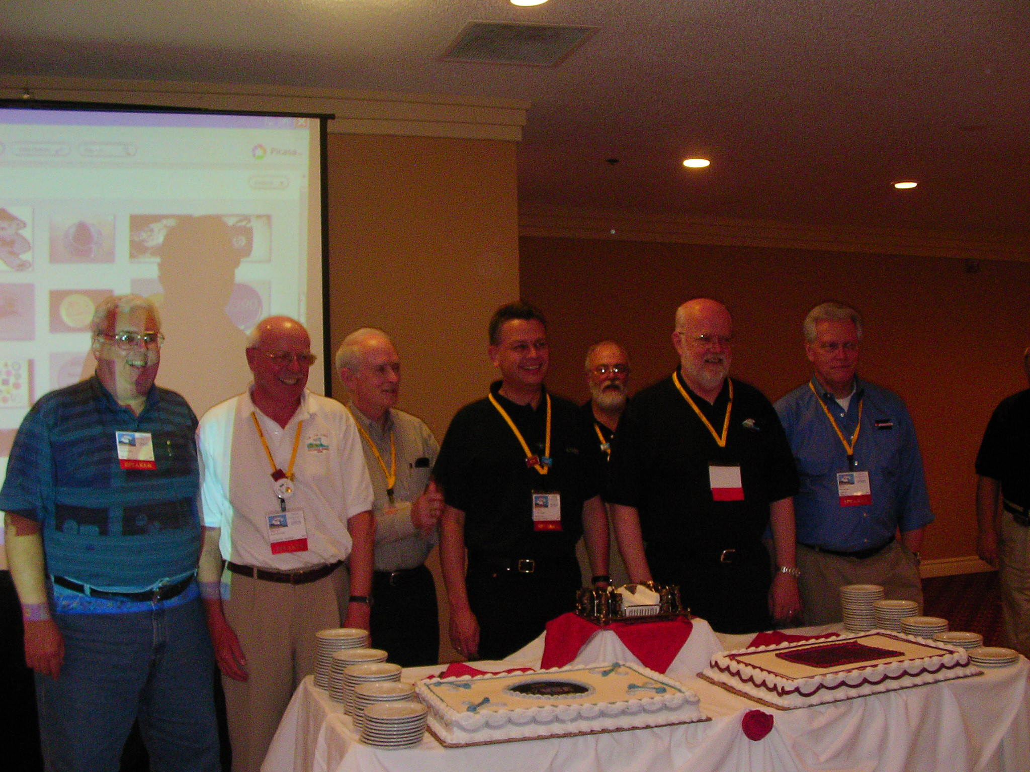 Members of VSE's history prepare to cut the cake.