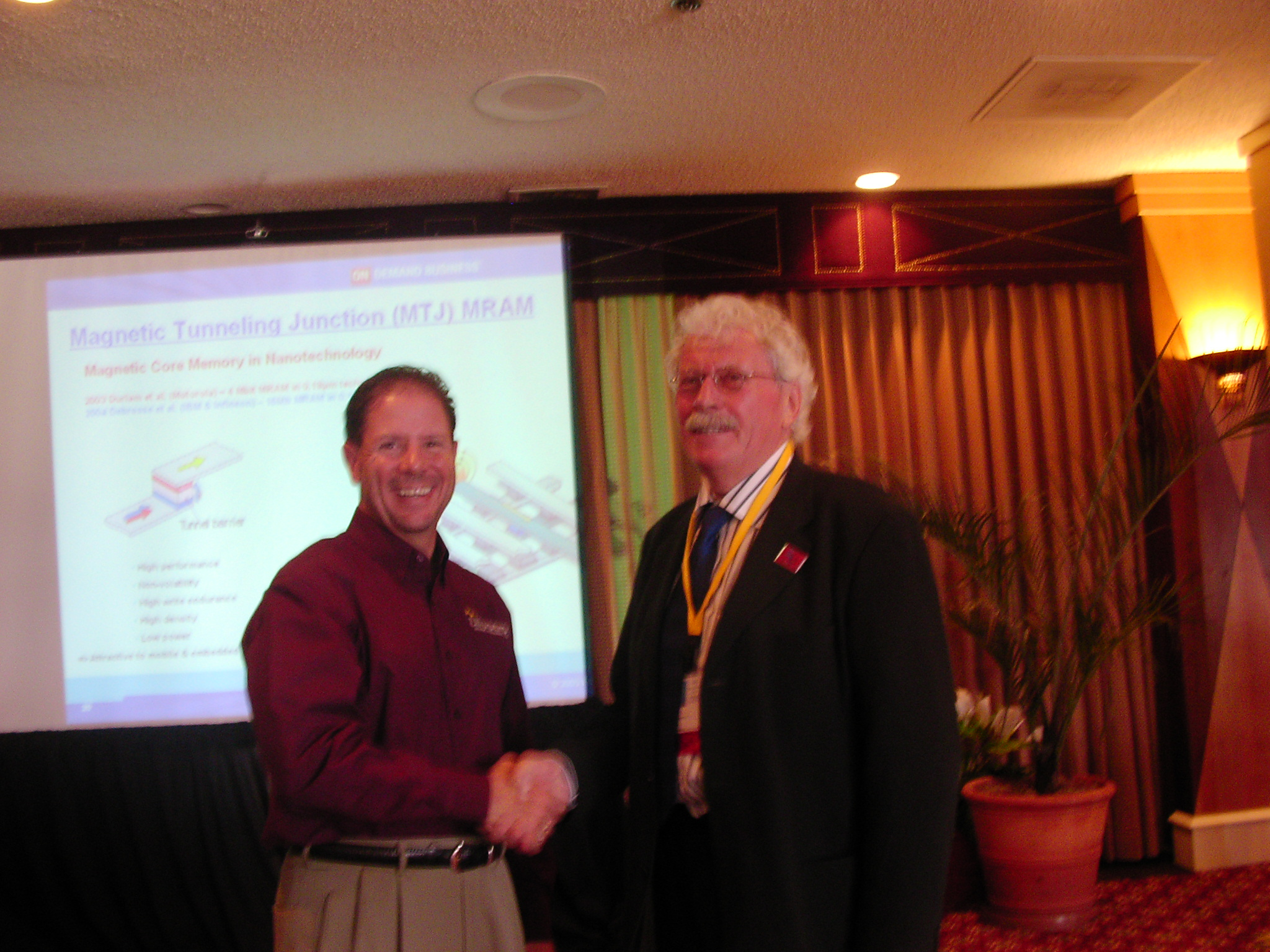 Eric Vaughan and Dr. Strassemeyer congratulate each other on a well-received session on the Future of the Mainframe.